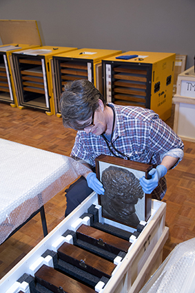 Nikki King Smith, Senior Conservator (Objects), unpacking and condition checking works for the National Picture exhibition